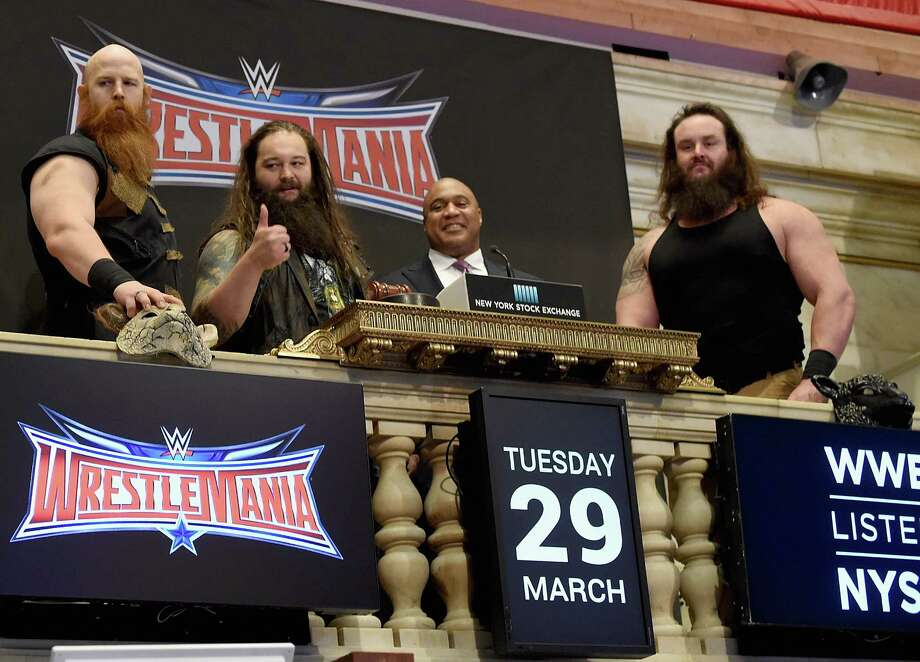 WWE stars (L-R) Erick Rowan, Bray Wyatt and Braun Strowman with Garvis Toler of the New York Stock Exchange to ring the opening bell on March 29, 2016 in New York City. (Photo by Jamie McCarthy/Getty Images) Photo: Jamie McCarthy / Getty Images / 2016 Getty Images