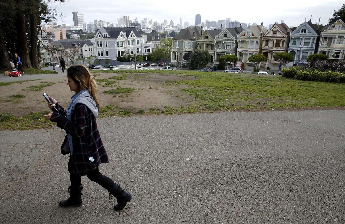 The Painted Ladies are in the background, an iconic San Francisco neighborhood.