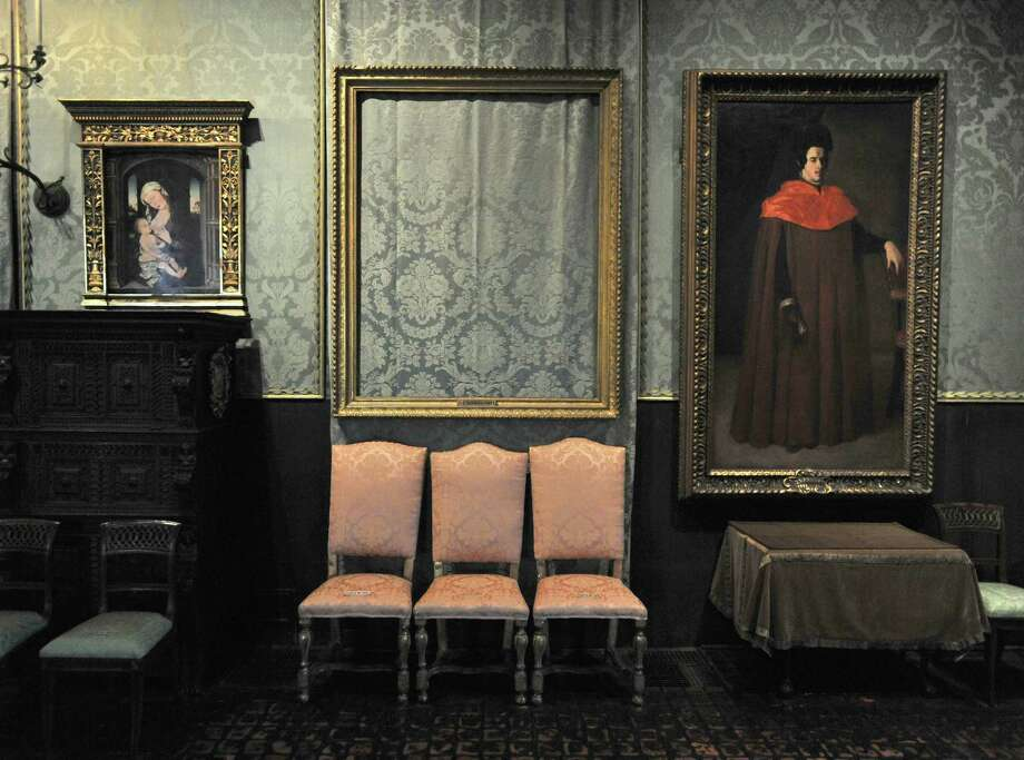 """In this Thursday, March 11, 2010 photo, the empty frame, center, from which thieves cut Rembrandt's """"Storm on the Sea of Galilee"""" remains on display at the Isabella Stewart Gardner Museum in Boston. The painting was one of more than a dozen works stolen from the museum in 1990 in what is considered the largest art theft in history. (AP Photo/Josh Reynolds) Photo: Josh Reynolds / FR25426 AP"""