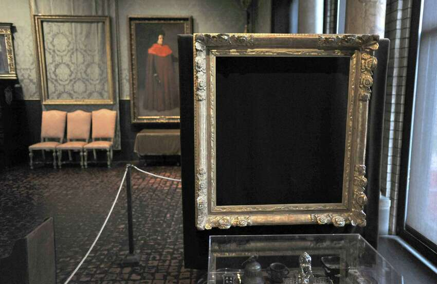 In this Thursday, March 11, 2010 photo, empty frames from which thieves took