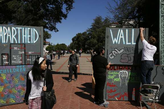 Students who preferred not to give their names set up a hand-made wall for a mock Israeli check-point demonstration near the Sather Gate on the University of California, Berkeley campus March 29, 2016 in Berkeley, Calif. The event was sponsored by Students for Justice in Palestine and was part of a week of events meant to raise awareness about the Palestinian situation.