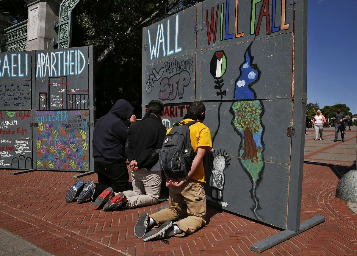 Protesters role play detained Palestinians at the border during a mock Israeli check-point demonstration near the Sather Gate on the University of California, Berkeley campus March 29, 2016 in Berkeley, Calif. The event was sponsored by Students for Justice in Palestine and was part of a week of events meant to raise awareness about the Palestinian situation.