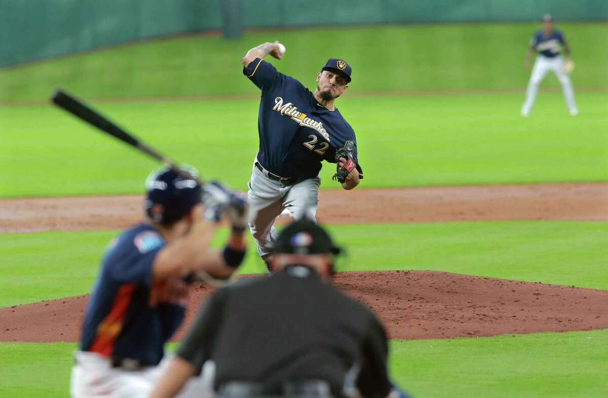 Milwaukee Brewers pitcher Matt Garza delivers a pitch to Houston Astro' Jose Altuve in the first inning of an exhibition baseball game Friday, April 1, 2016 in Houston.