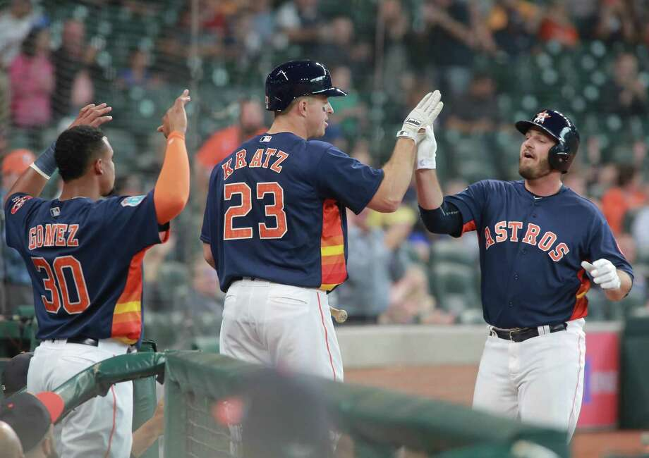 Houston Astros' Tyler White is greeted by teammates Erik Kratz and Carlos Gomez after his solo home run against the Milwaukee Brewers in the second inning of an exhibition baseball game Friday, April 1, 2016 in Houston. Photo: Richard Carson, AP / FR171014 AP