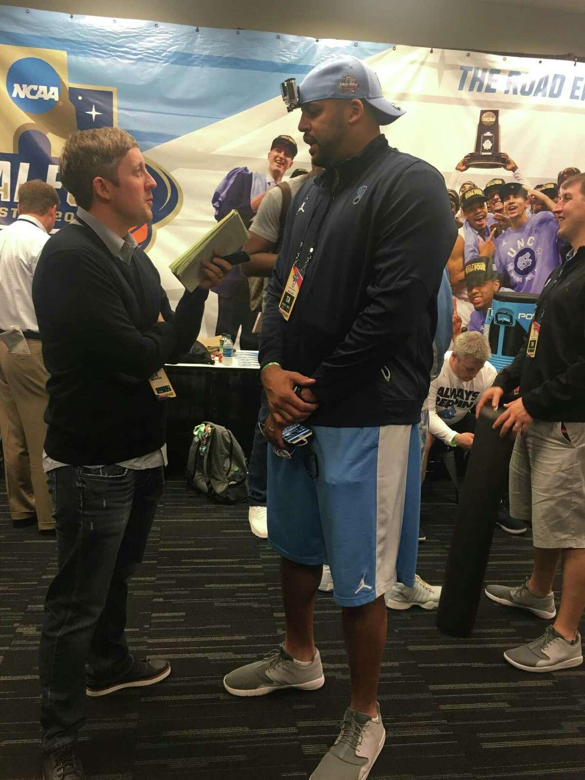 Former North Carolina star and national champion Sean May speaks with the media in the Tar Heels' locker room Friday at NRG Stadium.