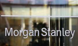 The Morgan Stanley logo is shown on its Times Square building, Tuesday, Oct. 18, 2011 in New York. Morgan Stanley said Wednesday, Oct. 19, 2011, it earned $2.2 billion in the third quarter, largely on accounting gains and increased investment banking revenue. (AP Photo/Mark Lennihan)