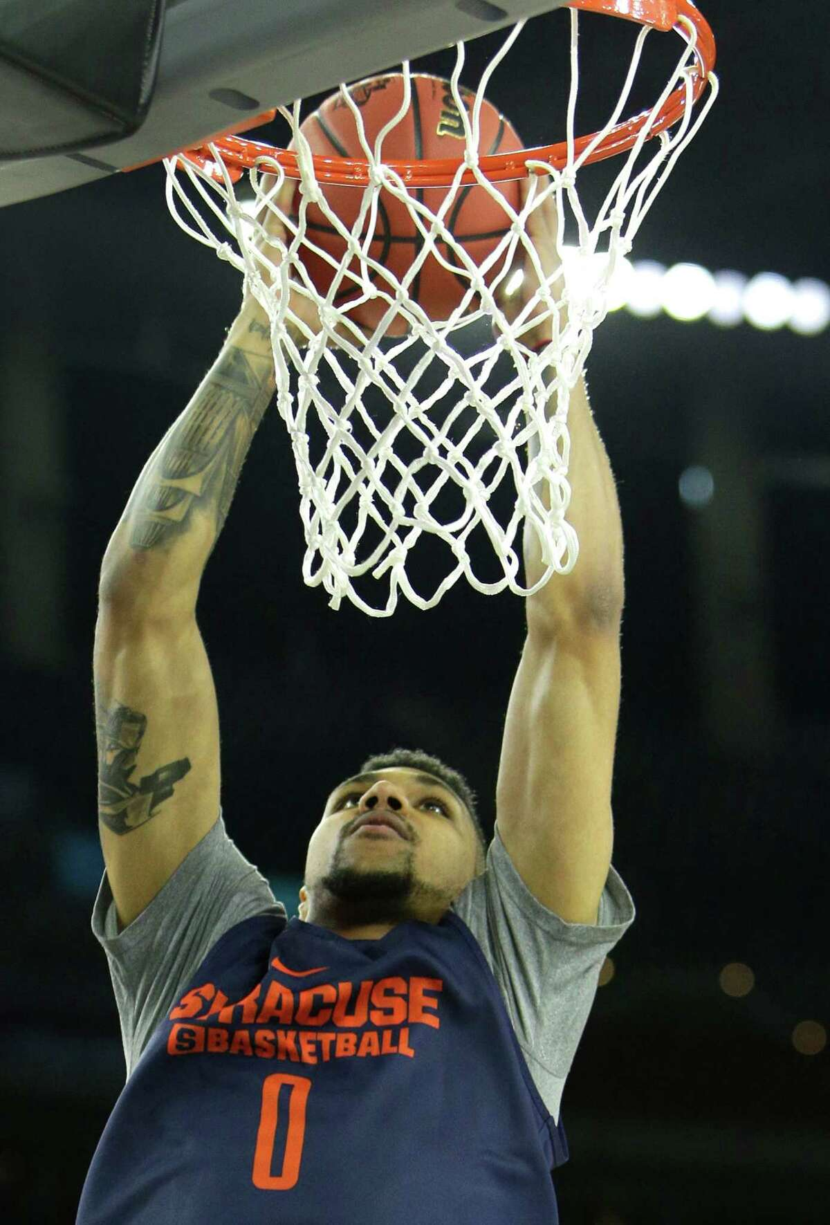 Syracuse forward Michael Gbinije (0) goes up for a dunk during practice for the NCAA Final Four at NRG Stadiium on Friday, April 1, 2016, in Houston.