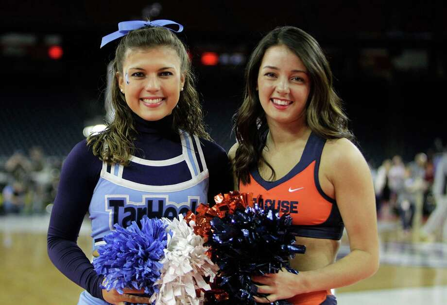 North Carolina cheerleader Carol DeSalva (left) and Syracuse cheerleader Amber Deamico cheered for rival high schools in Connecticut. DeSalva went to Barlow High School  in Redding and Deamico attended Masuk in Monroe. On Saturday they will be cheering on opposite sides of the court during the Final Four at NRG Stadium, in Houston, TX. Photo: Mark Mulligan, Houston Chronicle / © 2016 Houston Chronicle  News-Times freelance