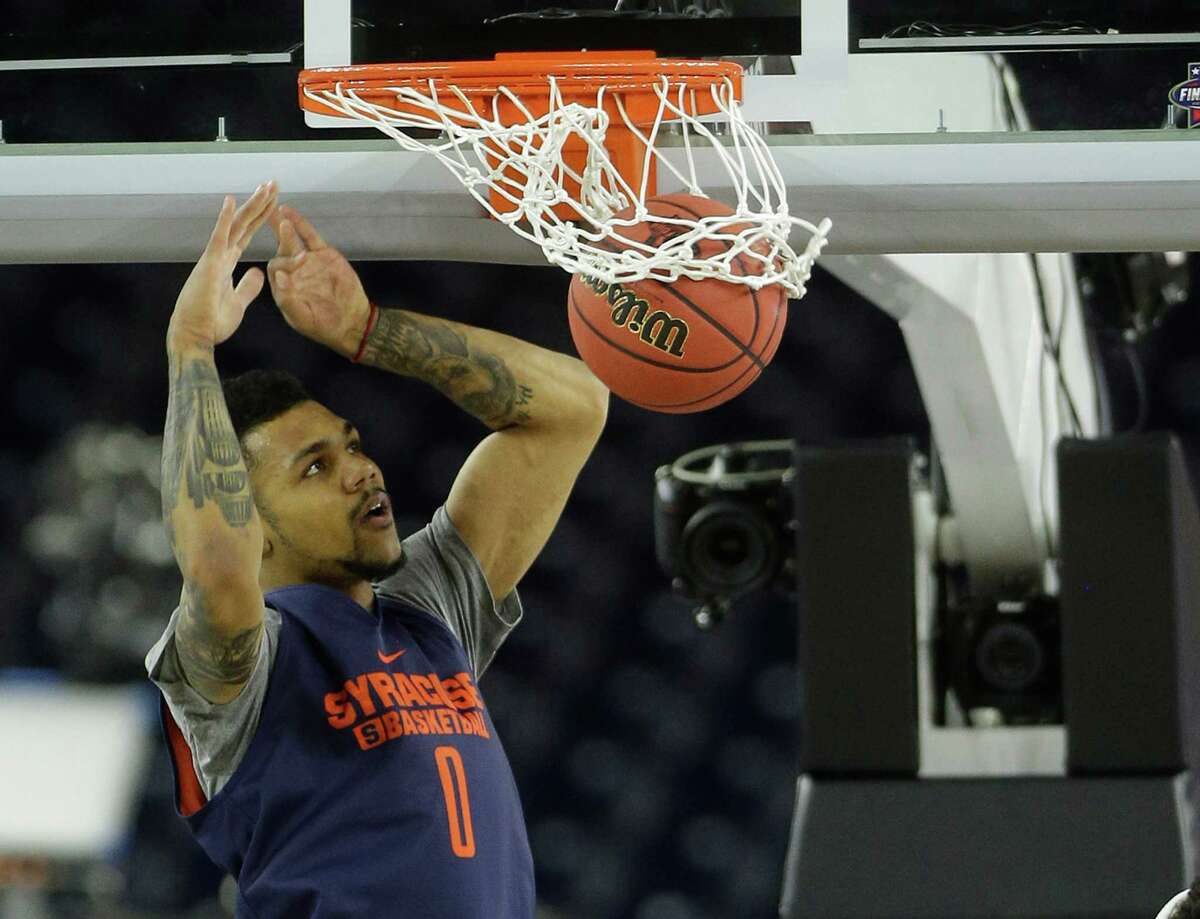 Syracuse forward Michael Gbinije (0) dunks during practice for the NCAA Final Four at NRG Stadiium on Friday, April 1, 2016, in Houston.