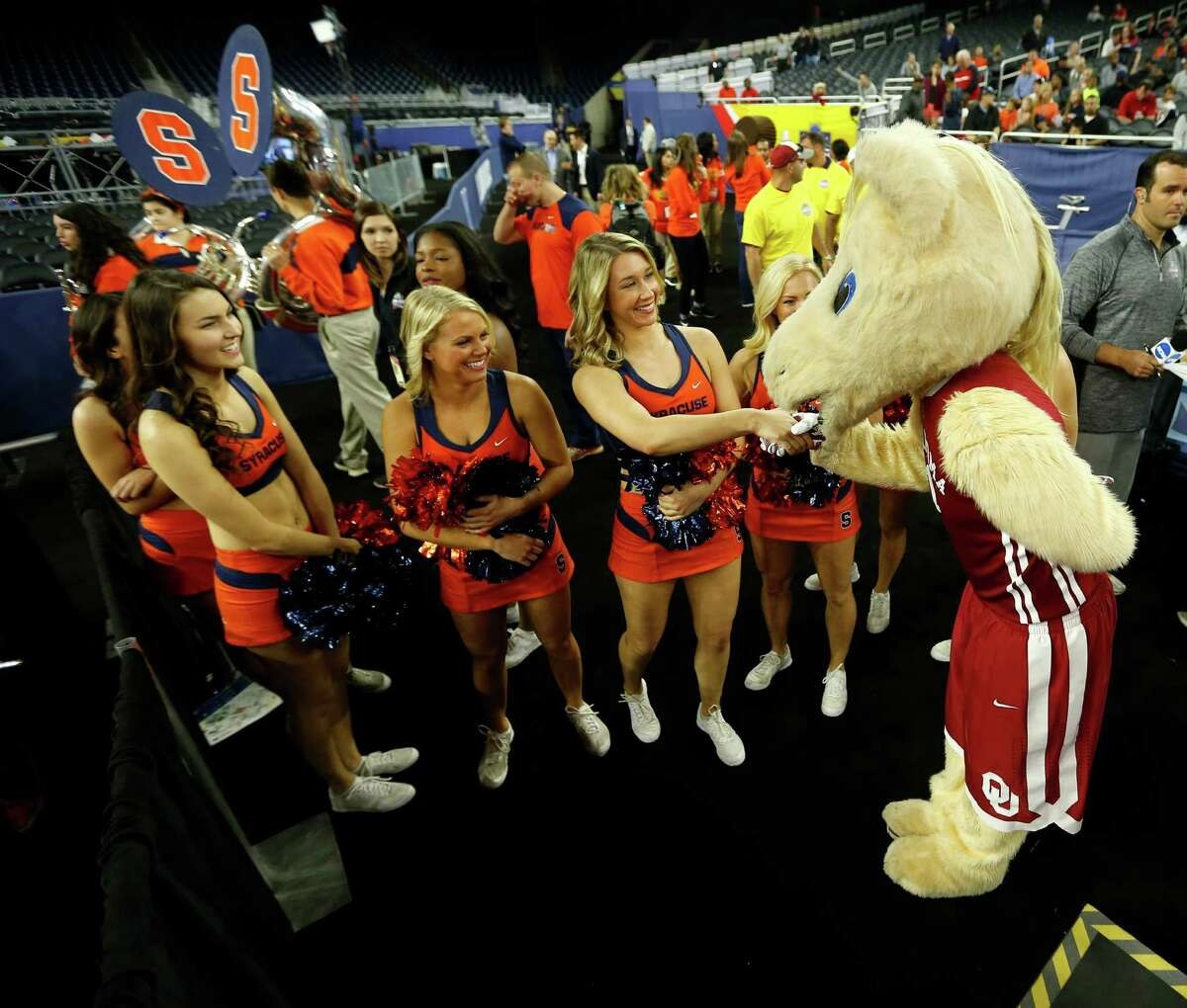 Oklahoma mascot kisses the hand of a Syracuse cheerleader during NCAA Final Four practices at NRG Stadium, Friday, April 1, 2016, in Houston.