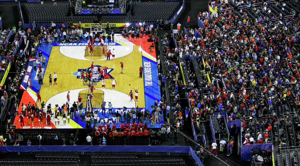 Fans watch as Oklahoma practices for the NCAA Final Four at NRG Stadium Friday, April 1, 2016 in Houston.