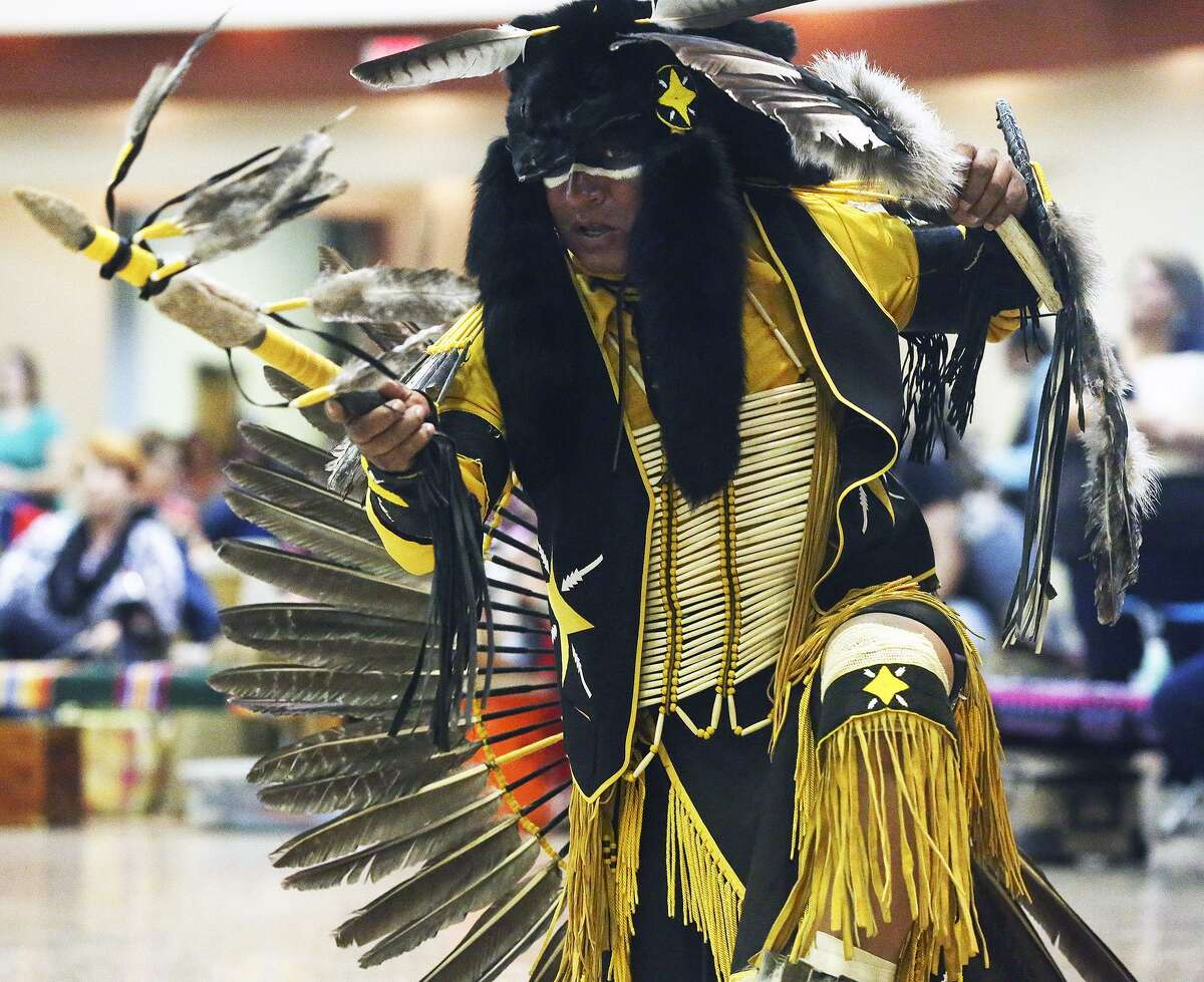 Tony Castaneda, Lipan Apache, performs in a Northern Traditional dance as American Indians in Texas hold a Pow Wow at the Alzafar Shrine Auditorium on Feb. 1, 2014.