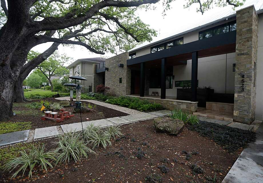 Mark and Lisa Livingston's Bellaire home is part of the Rice Design Alliance spring architecture tour. The couple built their home on a tree-filled lot two years ago. Photo: James Nielsen, Staff / © 2016  Houston Chronicle