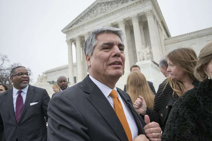 University of Texas at Austin President Gregory Fenves, center, and Gregory Vincent, left, UT's vice president for diversity, leave the Supreme Court in Washington, Wednesday, Dec. 9, 2015, following oral arguments in a case that could cut back on or even eliminate affirmative action in higher education.  (AP Photo/J. Scott Applewhite)