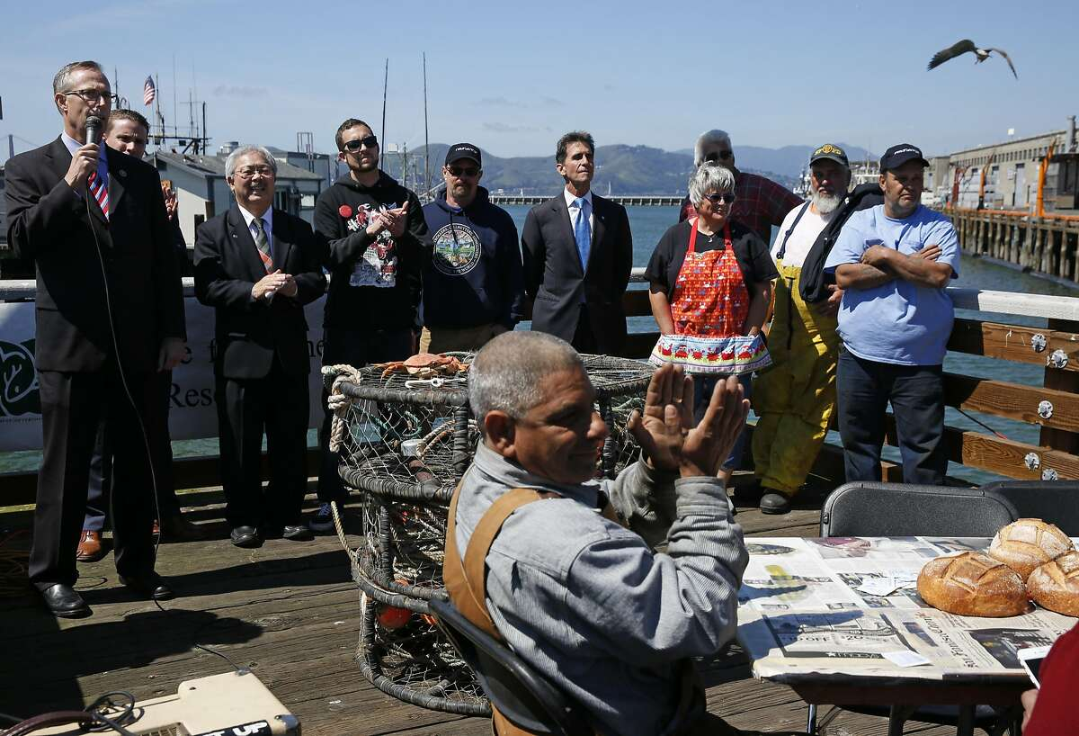 From left, Representative Jared Huffman speaks as he stands with Senator Mike McGuire, Mayor Ed Lee, Tim Sloane, Executive Director of Pacific Coast Federation of Fishermen's Associations, Mike Hudson, commercial salmon fisherman, Senator Mark Leno and Lori French along with other fishermen during a crab feed near Pier 45 on the Fisherman's Wharf April 1, 2016 in San Francisco, Calif.