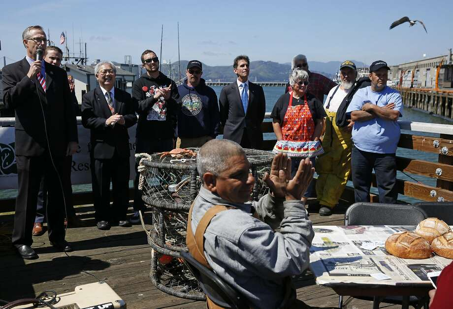 Rep. Jared Huffman (left) joined politicians and crabbing industry representatives at a crab feast near Pier 45. Photo: Leah Millis, The Chronicle