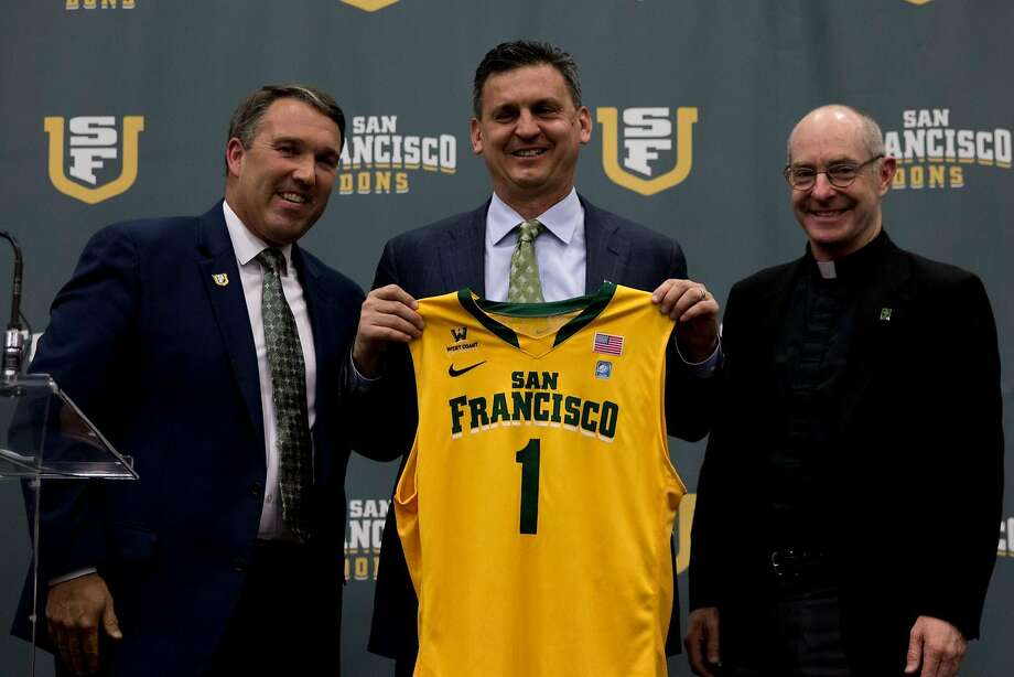 From left to right: USF Director of Athletics Scott Sidwell, Kyle Smith and University President Paul Fitzgerald, S.J. Photo: Mike Johnstone, USF Athletics