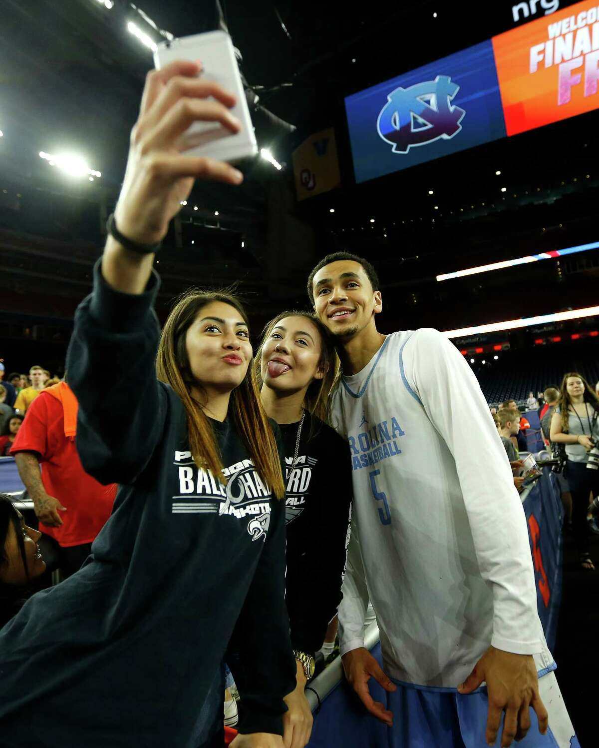 Girls take a selfie with North Carolina guard Marcus Paige (5) after UNC's NCAA Final Four practice at NRG Stadium, Friday, April 1, 2016, in Houston.