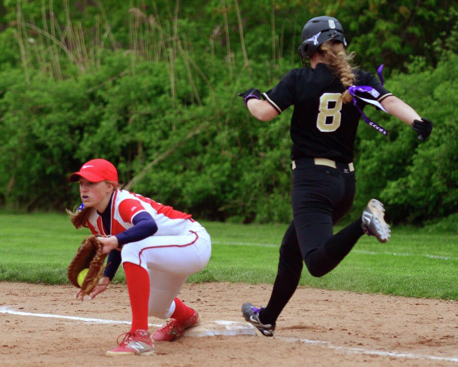 Jonathan Law's Erin Saley gets tagged out at first by Foran's Fallon Bevino, during softball action in Milford, Conn. on Wednesday May 14, 2014.  Law went on to beat its cross-town rival in the eighth inning, 4-0. Photo: Christian Abraham / Christian Abraham / Connecticut Post