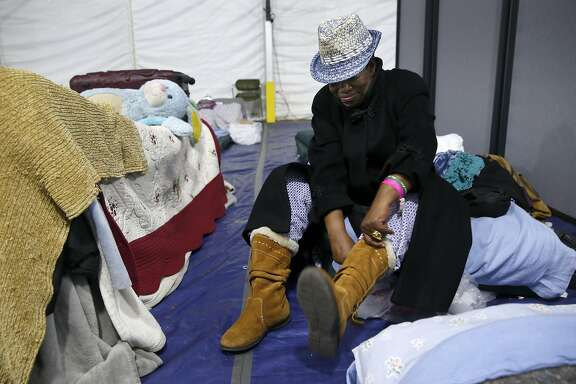 Miss Trotter prepares for to head out for the day inside the shelter on Pier 80 in San Francisco, Calif. on Friday, April 1, 2016.