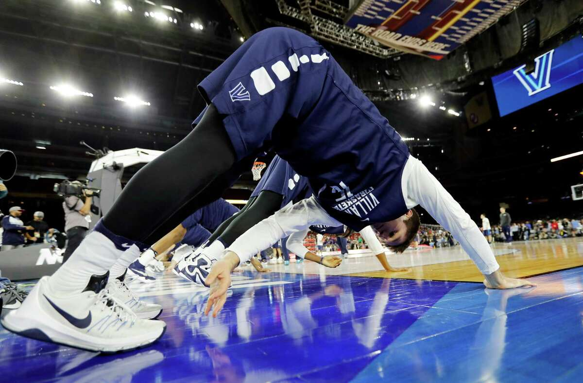 Villanova players stretch during a practice session for the NCAA Final Four college basketball tournament Friday in Houston. (AP Photo/David J. Phillip)