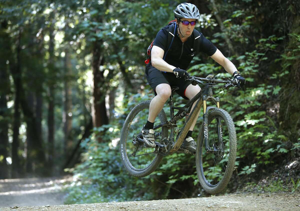 Mountain biker cruises the trails of the Marin open space in Mill Valley, California, on Fri. April 1, 2016.