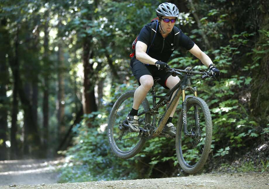 A mountain biker cruises the trails of the Marin open space, where rangers will enforce the 15 mph speed limit. Photo: Michael Macor, The Chronicle