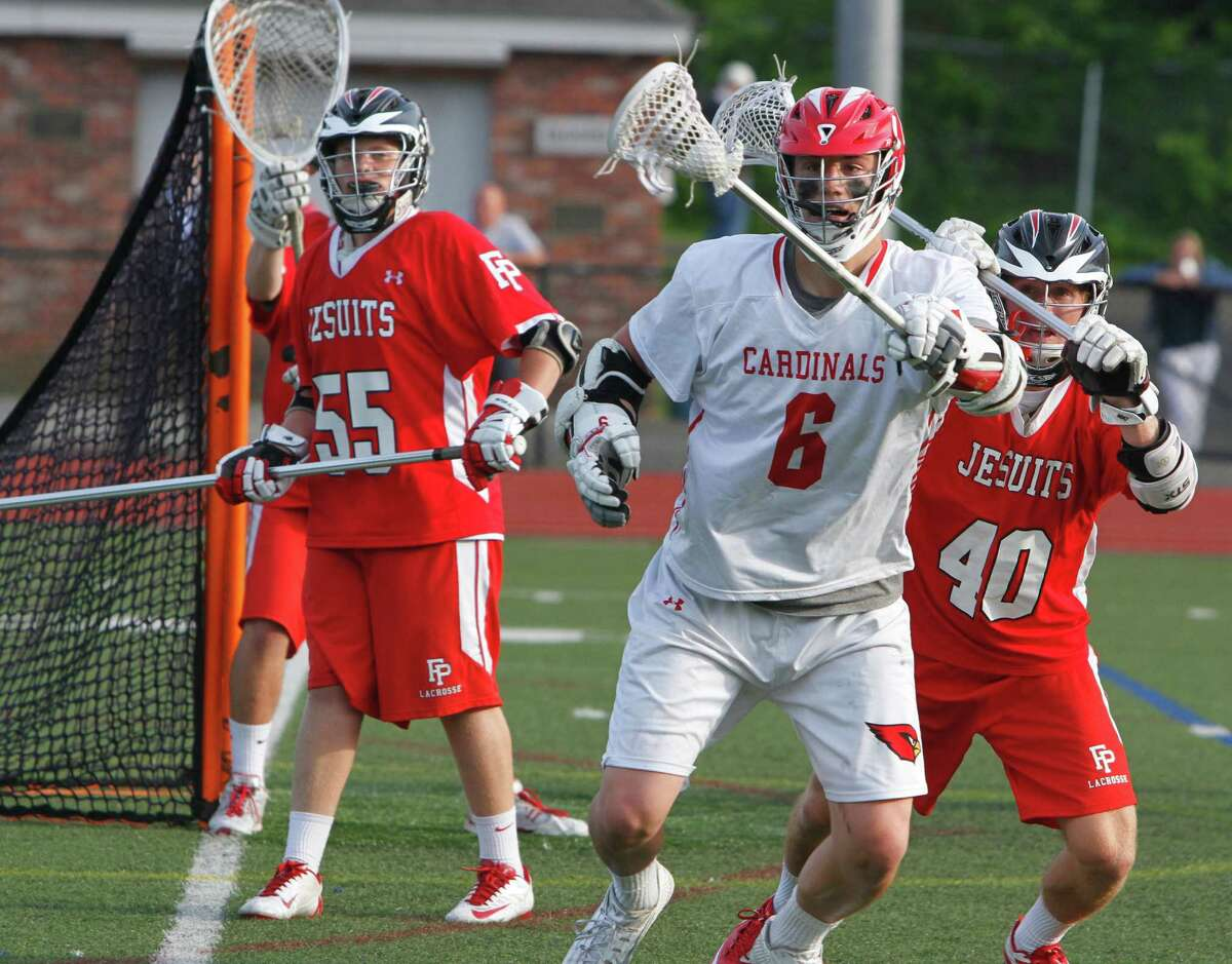 Greenwich's Scott Harrington controls a loose ball under pressure from Patrick Lambert, at right, during the first round Class L boys lacrosse at Greenwich High School in Greenwich, Conn. on Wednesday, June 3, 2015. Greenwich defeated Fairfield Prep 11-6.