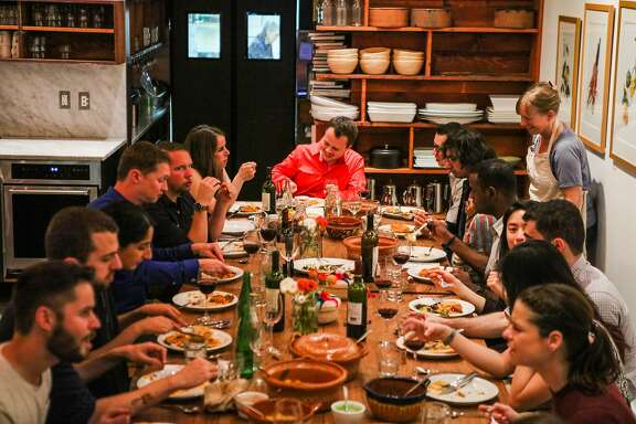 People enjoy a Mexican meal, prepared by chef Isabel Caudillo, at La  Cocina, in San Francisco, California, on Saturday, March 26, 2016.