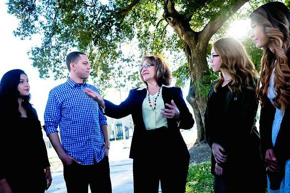 In this undated photo provided by the Eloise Reyes for Assembly 2016, Eloise Reyes, center, a member of the board of directors of San Bernardino Valley College, is seen at the schools campus in San Bernardino, Calif. Reyes, a Democrat, is challenging fellow Democrat, incumbent Assemblywoman Cheryl Brown, of San Bernardino, for the 47th Assembly District seat. (Violeta Vaqueiro/Eloise Reyes for Assembly 2016 via AP)