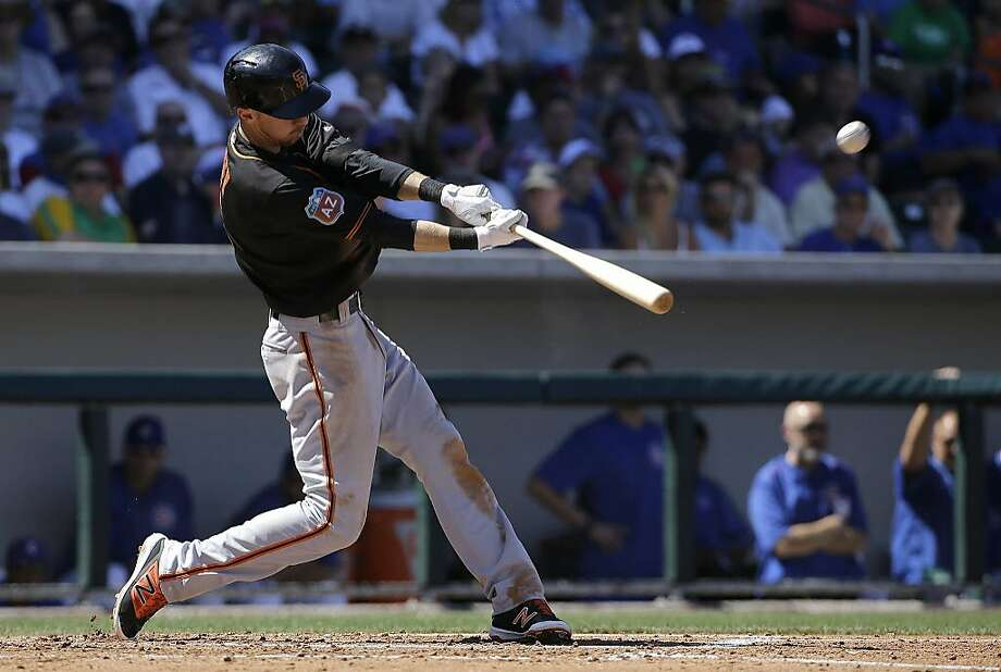 San Francisco Giants' Matt Duffy hits a solo home run against the Chicago Cubs during the third inning of a spring training baseball game in Mesa, Ariz., Saturday, March 26, 2016. (AP Photo/Jeff Chiu) Photo: Jeff Chiu, AP