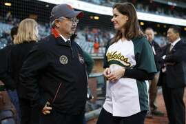 San Francisco Mayor Edwin Lee (left) and Oakland Mayor Libby Schaaf talk before the second game of the Battle of the Bay Series between the San Francisco Giants and the Oakland Athletics on Friday, April 1, 2016 in San Francisco, Calif.