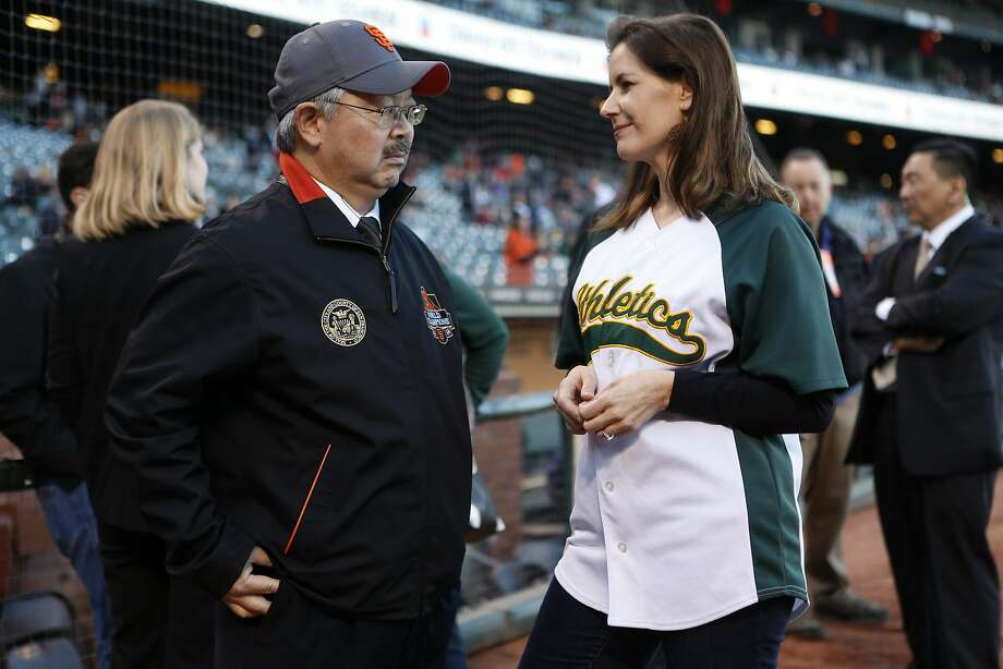 San Francisco Mayor Ed Lee and Oakland Mayor Libby Schaaf talk before the second game of the Battle of the Bay Series between the San Francisco Giants and the Oakland Athletics on Friday, April 1, 2016 in San Francisco. Photo: Beck Diefenbach, Special To The Chronicle