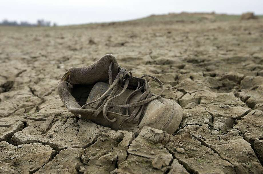 A shoe sits on the dry lake bed at Folsom Lake, in Folsom. Photo: Rich Pedroncelli, Associated Press