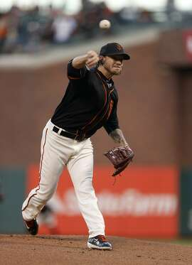 San Francisco Giants pitcher Jake Peavy releases the ball during the first inning of the second game of the Battle of the Bay Series against the Oakland Athletics on Friday, April 1, 2016 in San Francisco, Calif.