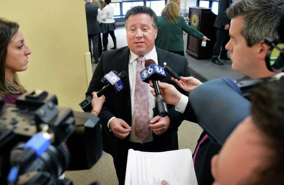 County Executive Dan McCoy, center, discusses the new regional immigrant assistance program with reporters Friday Jan. 22, 2016 in Albany, NY. (John Carl D'Annibale / Times Union)