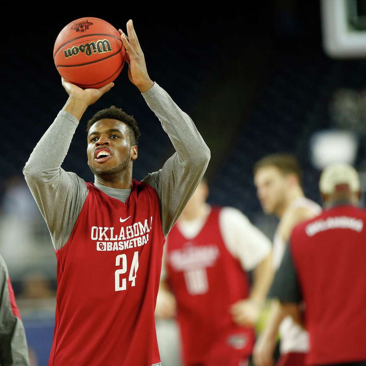 Oklahoma senior guard Buddy Hield (24) gets acclimated to the airy expanse of NRG Stadium on Friday when the Sooners held a workout ahead of their semifinal game against the Villanova Wildcats.