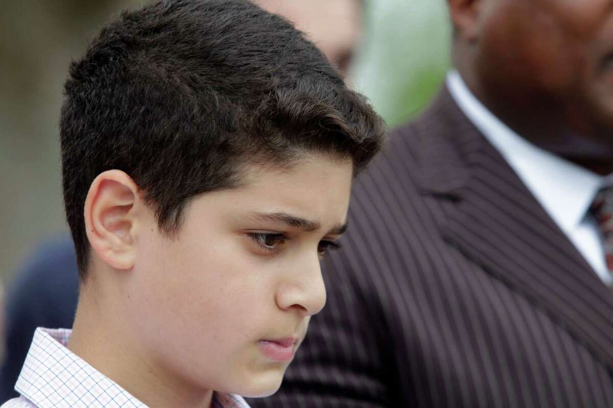 """Waleed Abushaaban, 12, returned to First Colony Middle School in Sugar Land on Friday, one day after one of his seventh-grade teachers allegedly referred to him as a """"terrorist.'' The teacher has been placed on paid administrative leave, Fort Bend ISD officials said."""