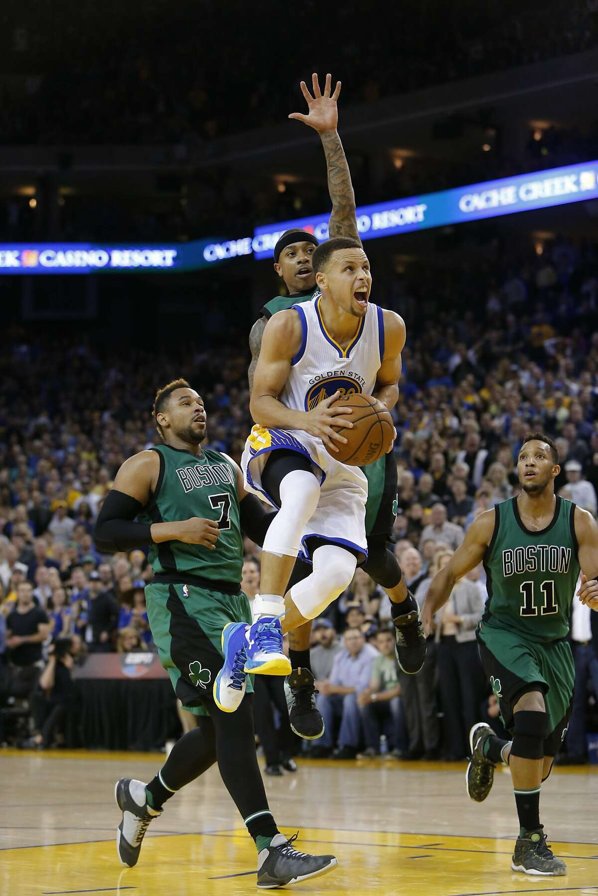 Warriors' Stephen Curry, 30 drives past the Celtics' Isaish Thomas, 4 in the second half, as the Golden State Warriors went on to lose to the Boston Celtics 106-109 in NBA action at Oracle Arena, in Oakland, California, on Fri. April 1, 2016