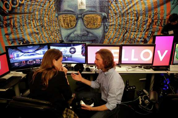 Erin Shipley talks with Brian Eppert, the CTO of V, a widget & utility platform for VR, during BOOST VC, the premier seed-stage accelerator for virtual reality and blockchain companies to share their visions and products, in San Mateo, California, on Thurs. March 31, 2016