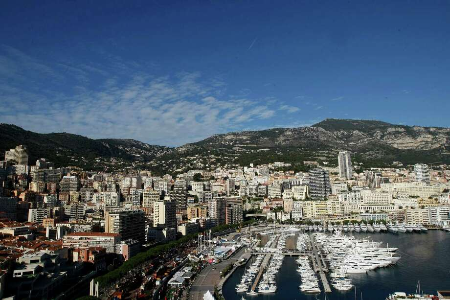 FILE - This Dec.12, 2014 file photo shows the Monaco principality and its yachts docked in the harbour.  Monaco's government says it's investigating how an alleged vast oil corruption scandal involving a Monaco-based company long went unnoticed, even though the principality has opened up its financial sector and cracked down on tax dodging. (AP Photo/Claude Paris, File) Photo: Claude Paris, STR / AP