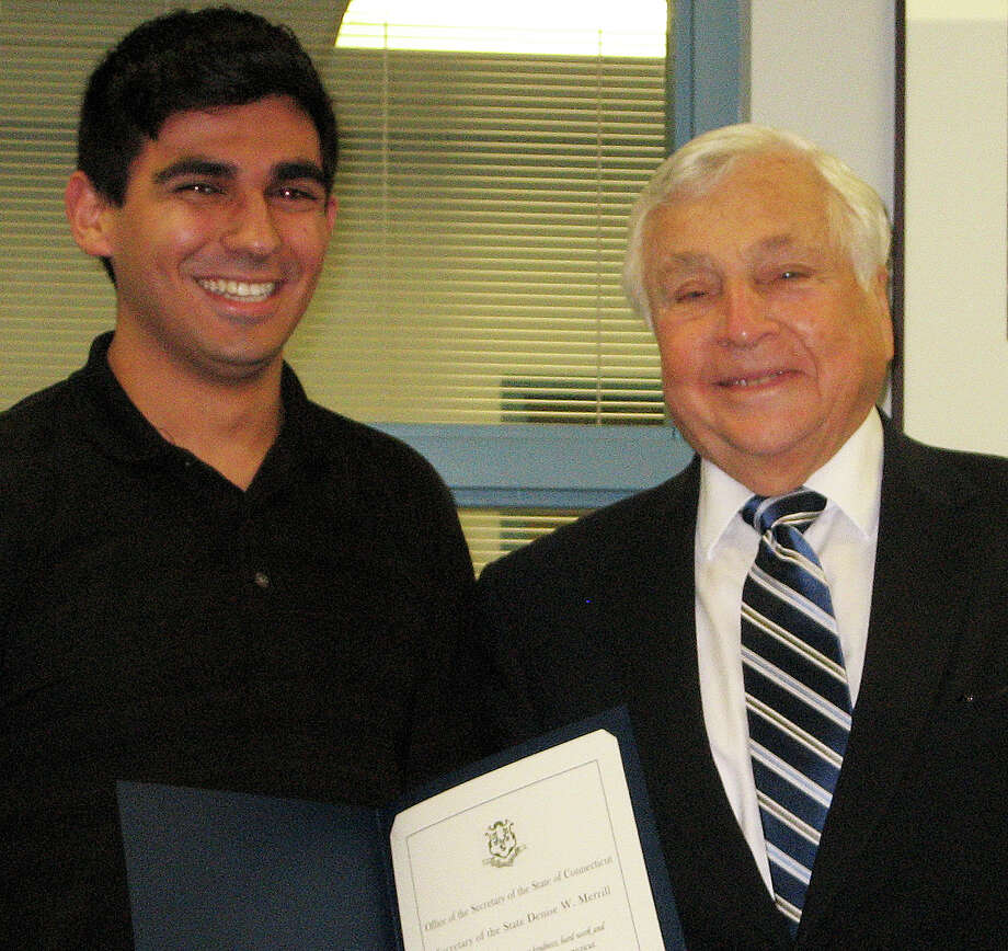 Jaime Bairaktaris, left, a Staples High School senior, with Superintendent of Schools Elliott Landon, has received a Certificate of Recognition from the Secretary of the State and the Connecticut Citizenship Fund. Photo: Contributed Photo / Westport News