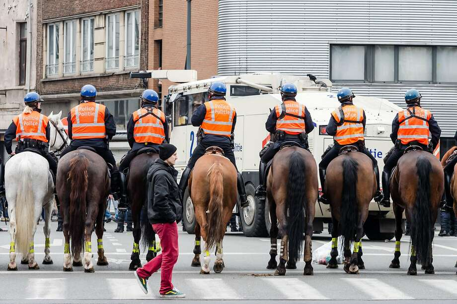 Mounted police officers secure an area in the Molenbeek neighborhood of Brussels. Police detained about two dozen demonstrators Saturday. Photo: Geert Vanden Wijngaert, AP