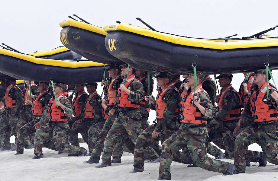 Navy SEAL trainees carry rafts at the Naval Amphibious Base Coronado near San Diego in 2009. Some members lament the commercialization of the unit. Photo: Denis Poroy, AP