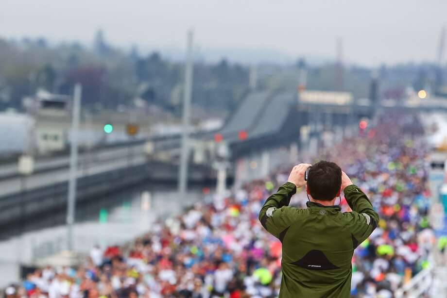 Pedestrians got their chance to cross the new 520 Bridge on April 2,  2016. On Monday, April 11, 2016, the westbound lanes of the new bridge  opened to traffic. Photo: GENNA MARTIN, SEATTLEPI.COM