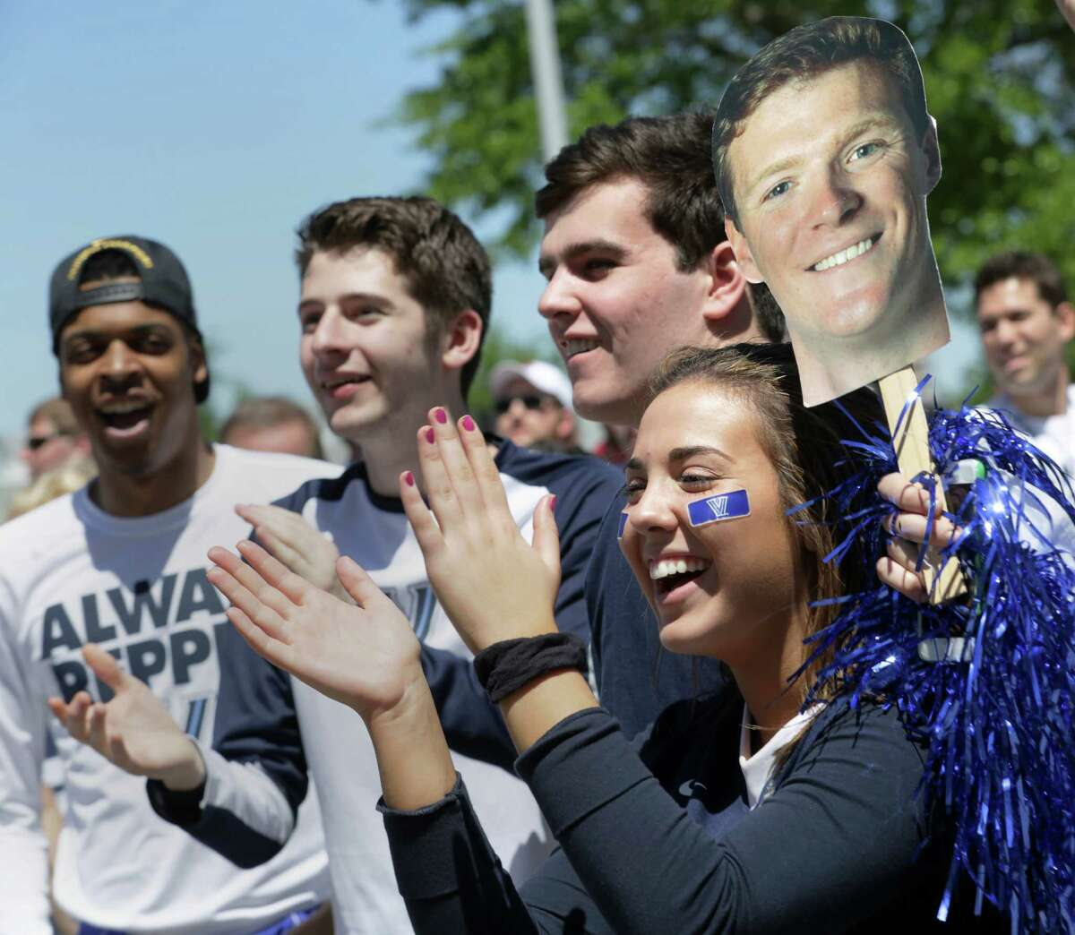 Katelyn O'Donnell, 19, from right, Cris Caggiano, 17, JonPaul Crichton, 20, and Ryan Cooke, cheer for Villanova before game one of the NCAA national semifinals, Saturday, April 2, 2016, in Houston.