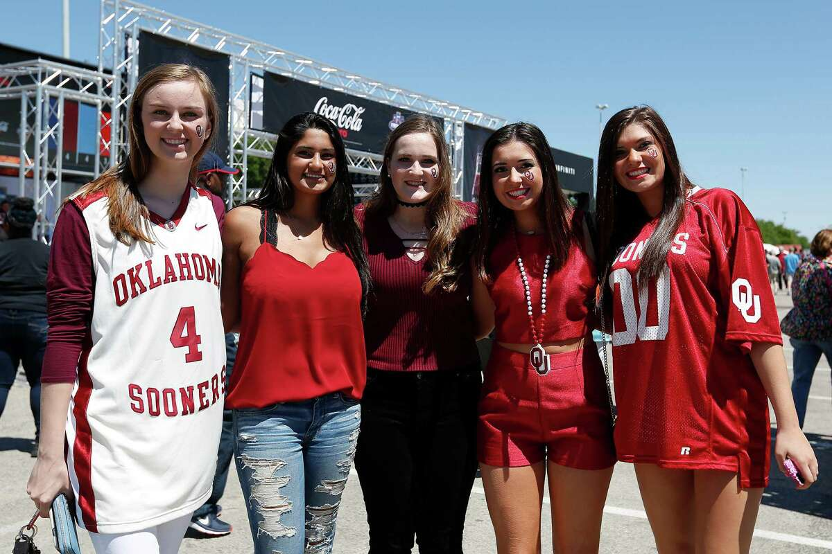 Fans enjoy the pre-game festivities outside of NRG Stadium for the NCAA Final Four, Saturday, April 2, 2016, in Houston.
