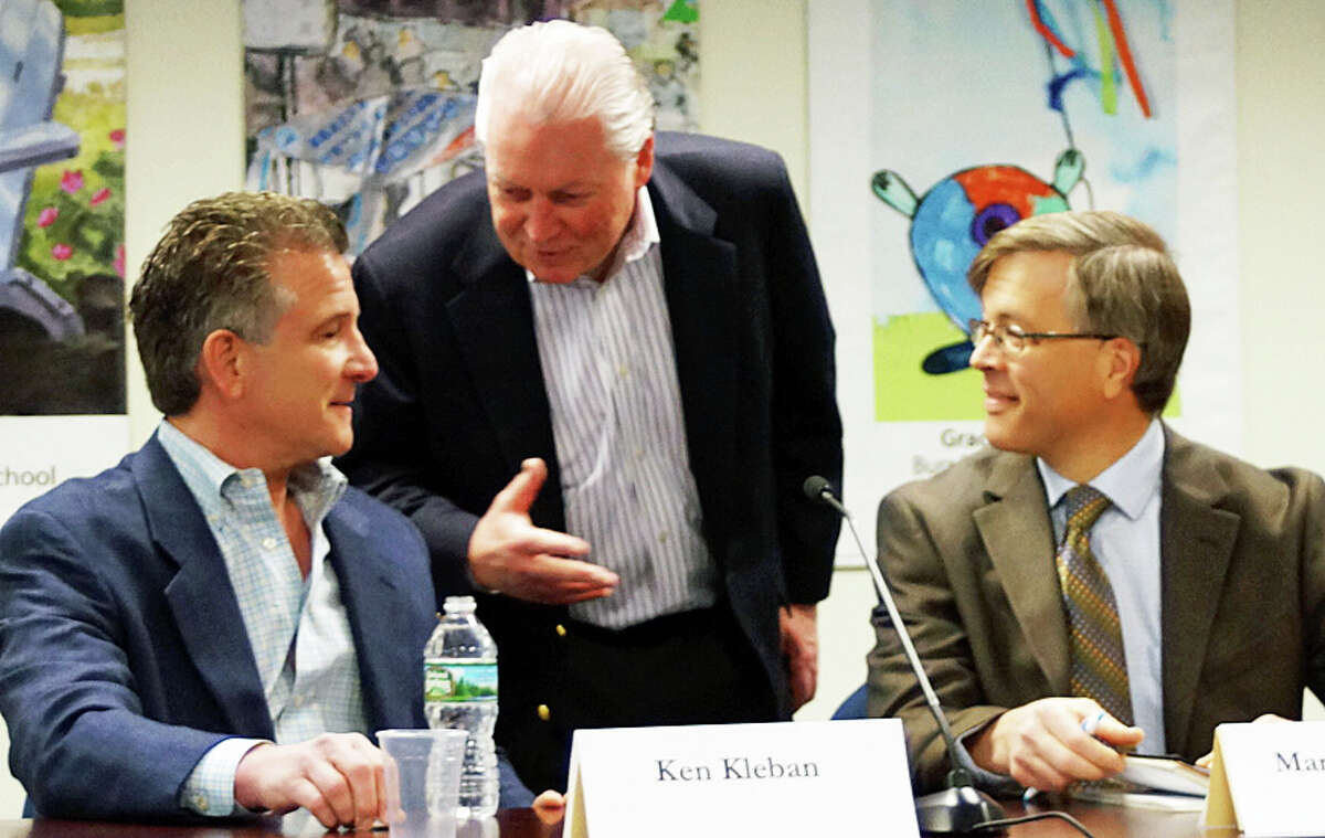 First Selectman MichaelTetreau, center, talks with Ken Kleban, president of Kleban Properties, left, and Economic Development Director Mark Barnhart before the start of a League of Women Voters forum Satuday on the future of the General Electric property.
