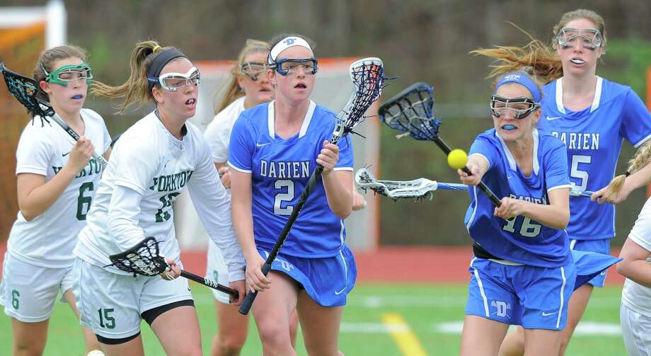 Darien Kaeleigh Morrill and Anna Stein chase a loose ball in the first half of a non-league girls lacrosse match up at Yorktown High School on April 2, 2016 in Yorktown, New York. Darien defeated Yorktown 12-9. Photo: Matthew Brown / Hearst Connecticut Media / Stamford Advocate