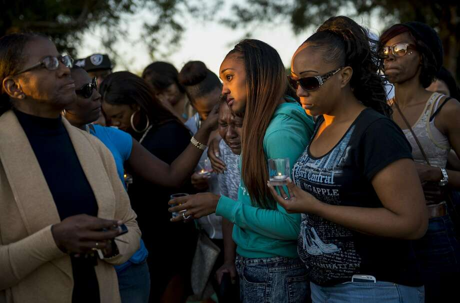 Family and friends gather at Pollack Ranch Park in South Sacramento on Friday, April 1, 2016, to remember Jerome Butler. Butler who on Wednesday, March 30, 2016, died after taking what he believed was a Norco pill given to him by a friend. The pill is believed to have contained the powerful painkiller fentanyl. Butler is one of several people in Sacramento County in recent days to die in a recent wave of opiate overdoses. As of Friday morning, 36 overdose cases and nine deaths linked to the synthetic opioid fentanyl have been reported to the Sacramento County Department of Health and Human Services. Public health officials believe that fentanyl, a powerful synthetic opioid that can cause cardiac arrest, was laced into counterfeit Norco tablets, a common prescription painkiller. They're urging people not to take prescription-type pills that haven't been prescribed by and obtained from a physician or pharmacy. Photo: Andrew Seng, Aseng@sacbee.com